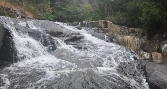 THE SCENIC MONUMENT OF SON LONG WATERFALL